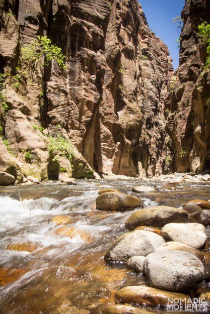 The Virgin River flows between rocks inside The Narrows.