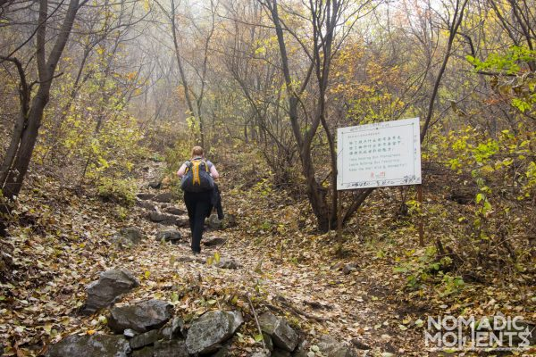 A hiker makes the way up the path from Xizhazi Village to the Unrestored Section of The Great Wall of China.