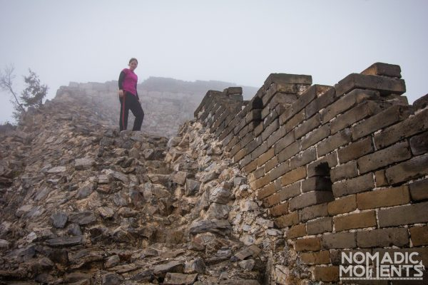 A hiker in the fog on the Great Wall of China