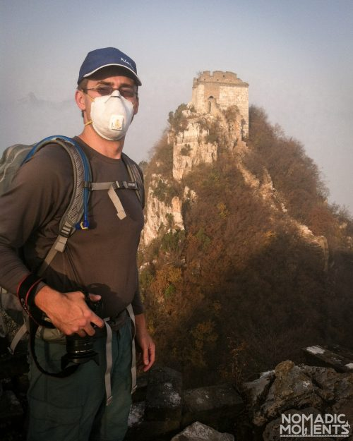 A hiker from Jiankou to Mutianyu wears a mask because of the pollution in the area.