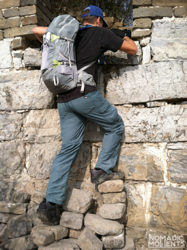 A hiker attempt to climb into a tower on an Unrestored Section of The Great Wall