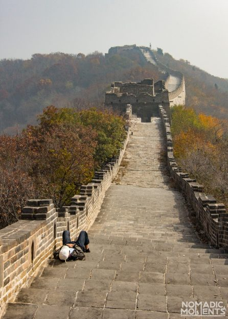 A visitor rests on the path of Mutianyu