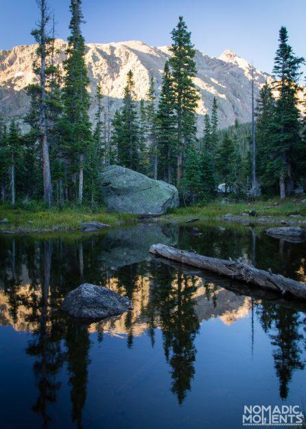 Small pond reflection of the mountainous terrain near Upper Cataract Lake.