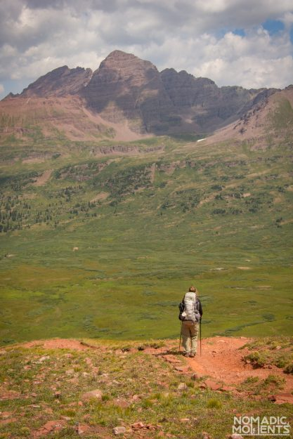 A backpacker descends the Frigid Air Pass while hiking the Four Pass Loop.