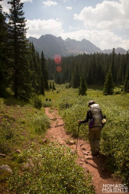 A hiker on the trail of Colorado's Four Pass Loop.