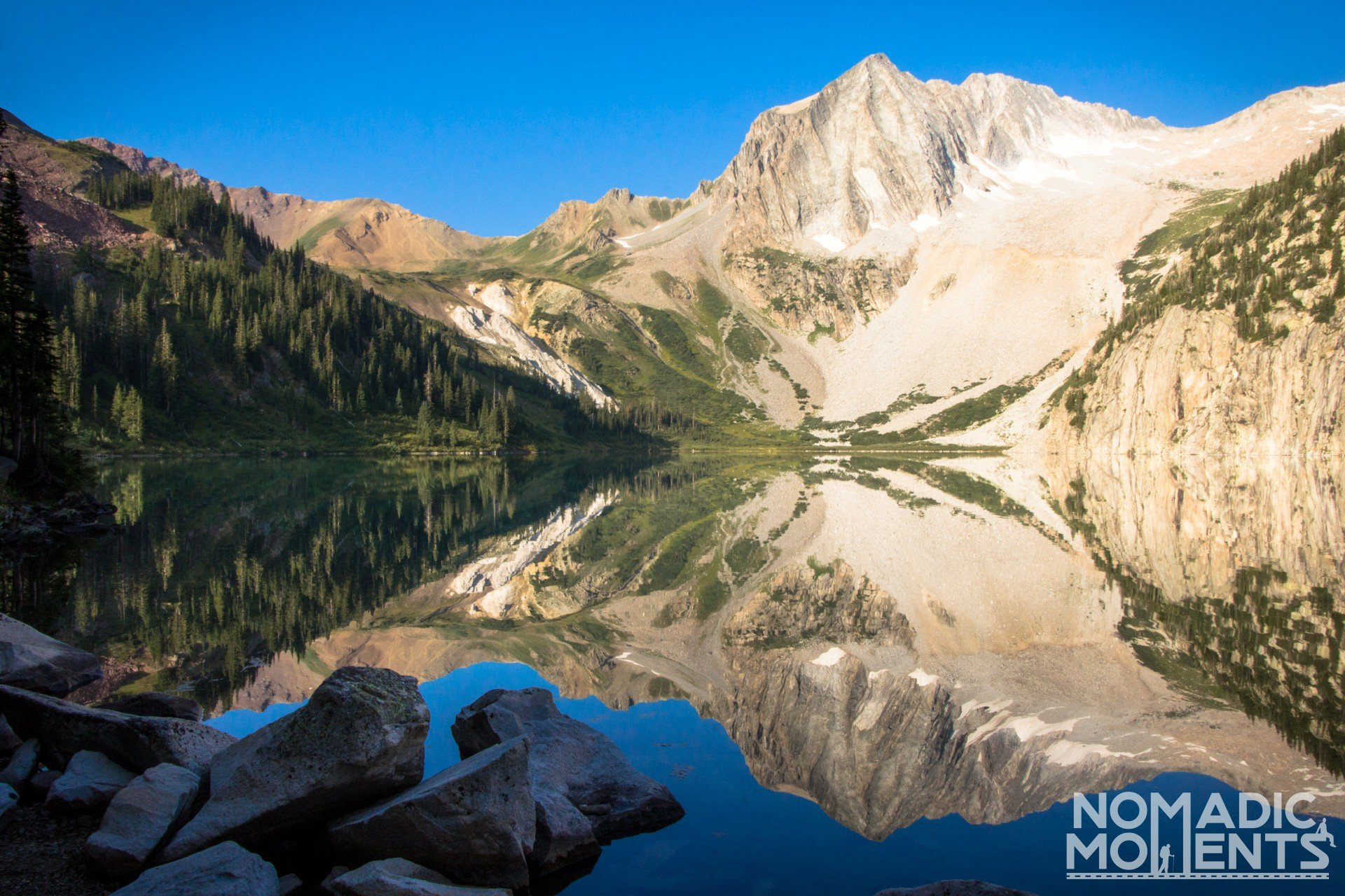 Reflections of Snowmass Mountain on Snowmass Lake.