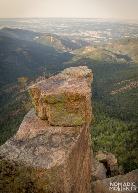 A naturally formed rock selfie seat on Colorado's St. Peters Dome.
