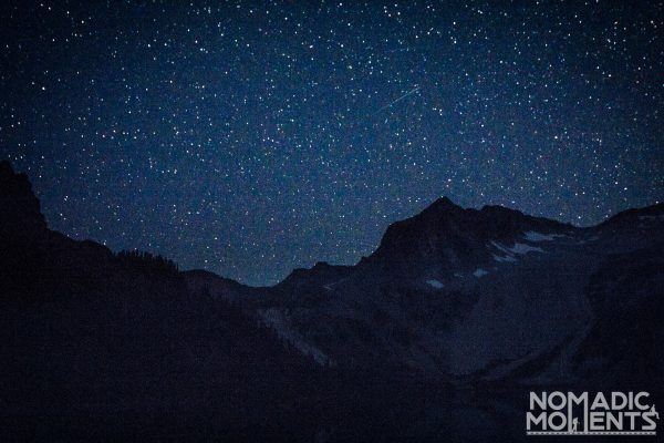 Snowmass Mountain and lake at night.