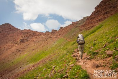 A backpacker hiking the Four Pass Loop.