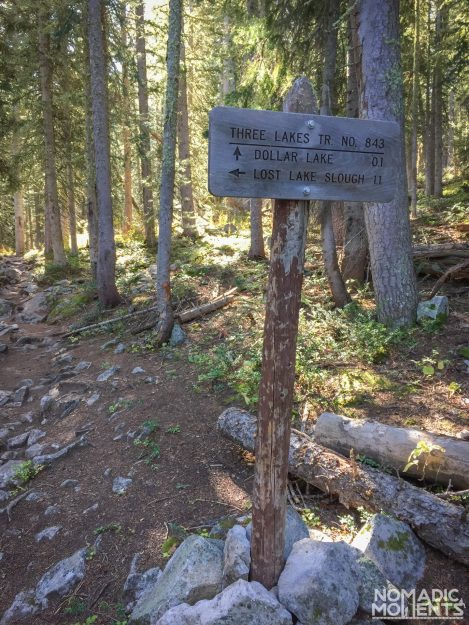 A directional sign on the Three Lakes Loop trail.