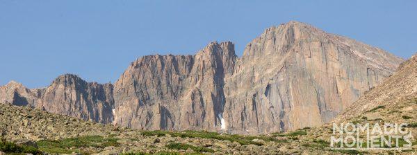 A jagged peak rises above a barren landscape.