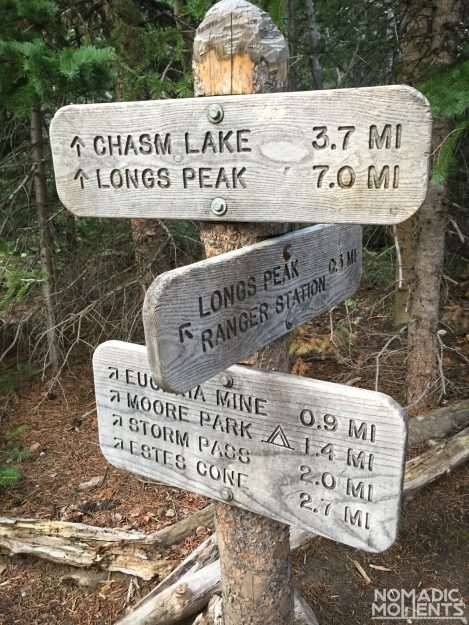 A sign with many different arrows and distances.