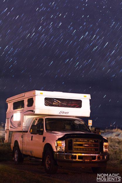 A truck camper under the stars.