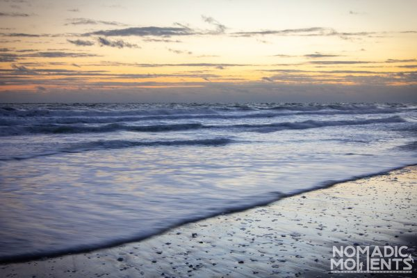 A sunrise over the ocean waves on a beach in the Outer Banks.