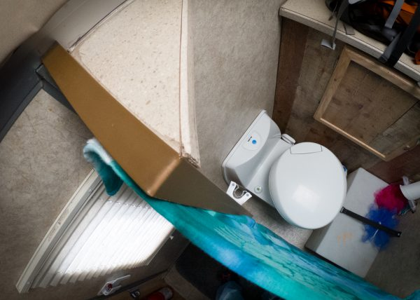Cassette toilet in place with a new wall and curtain.