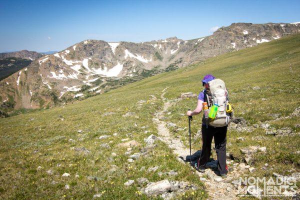 A hiker follows the trail down Buchanan Pass