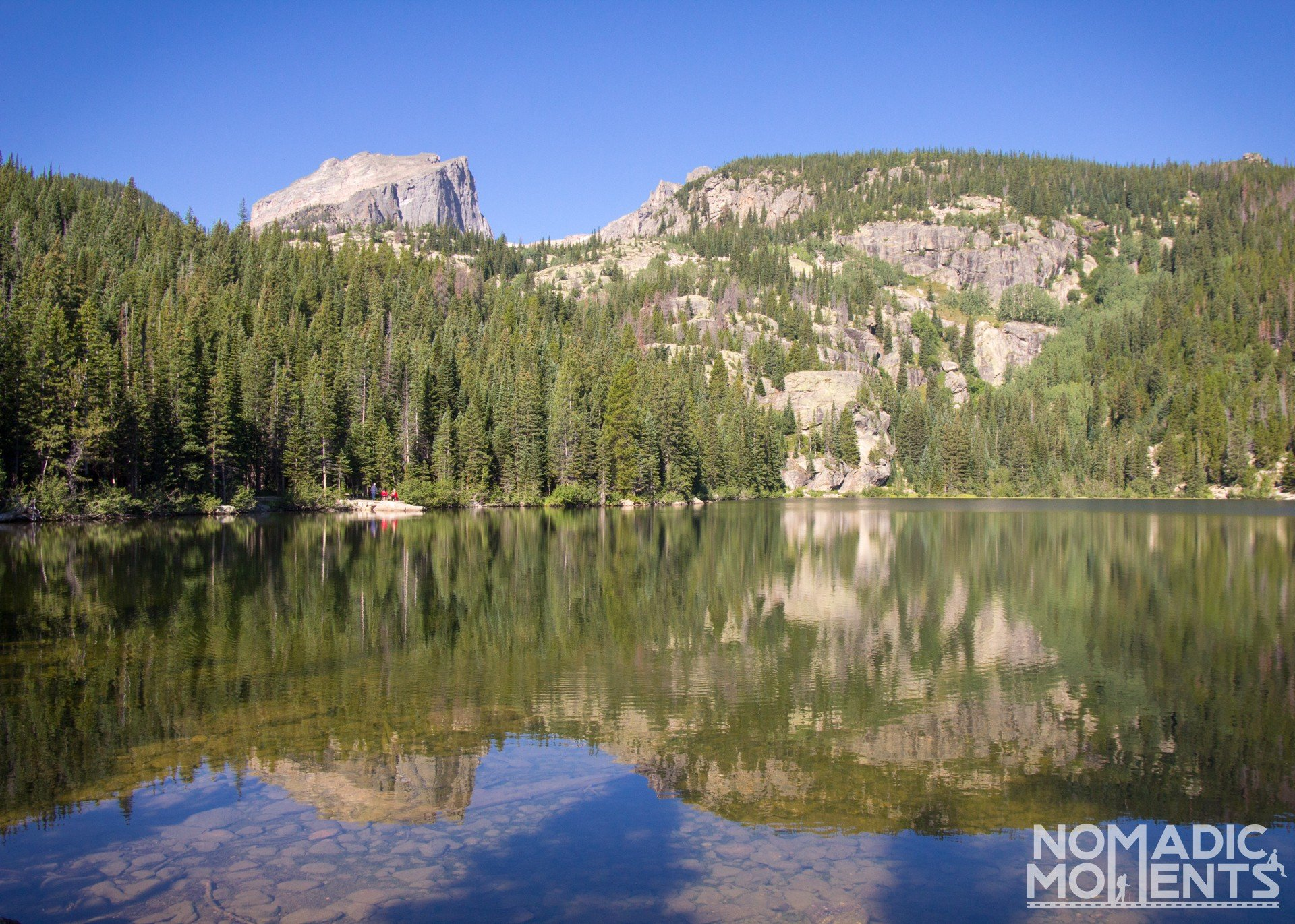 Bear Lake with reflective views of the surrounding peaks.