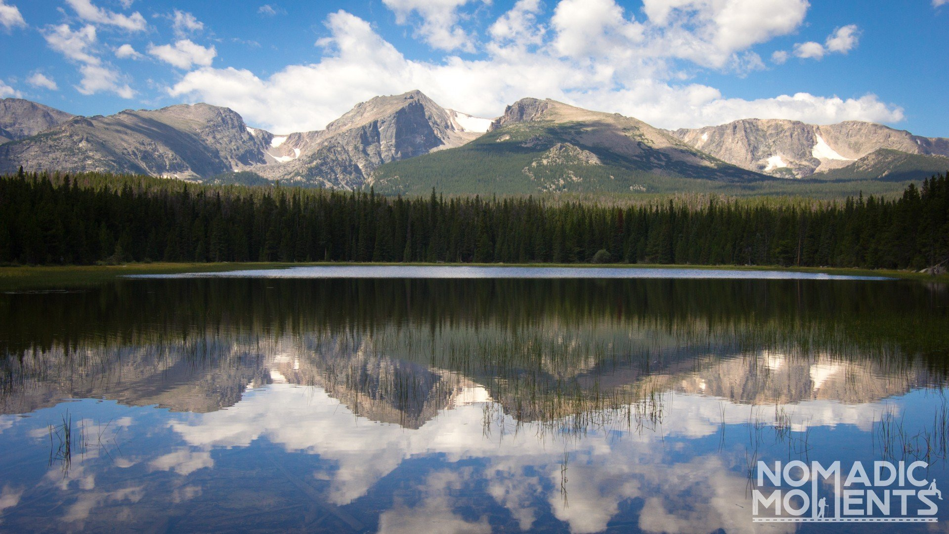 Bierstadt Lake with reflections of the surrounding mountain peaks.