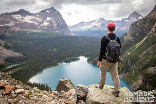 Hiker overlooking Lake O'Hara from the Yukness Ledges