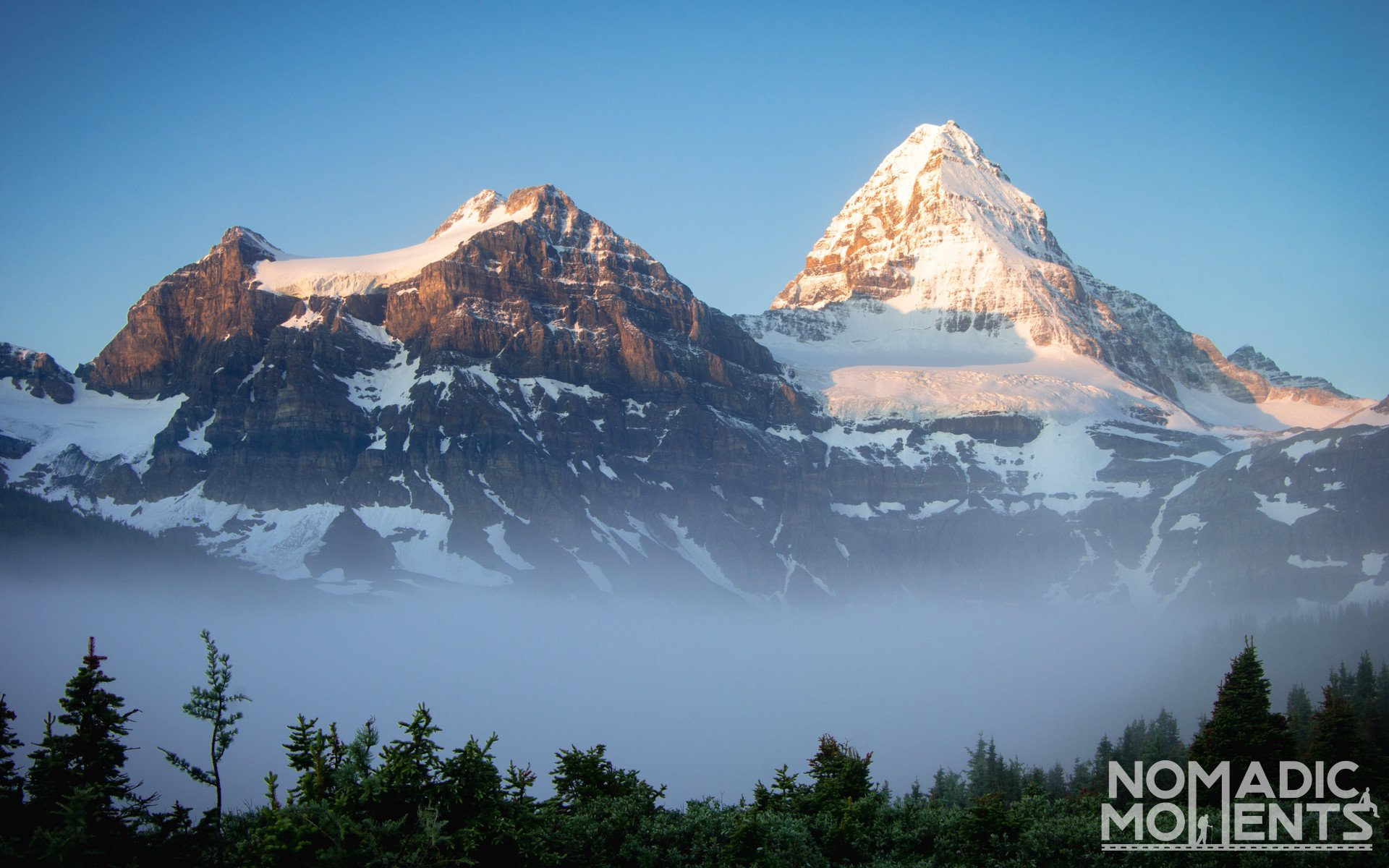Mount Assiniboine above the Clouds
